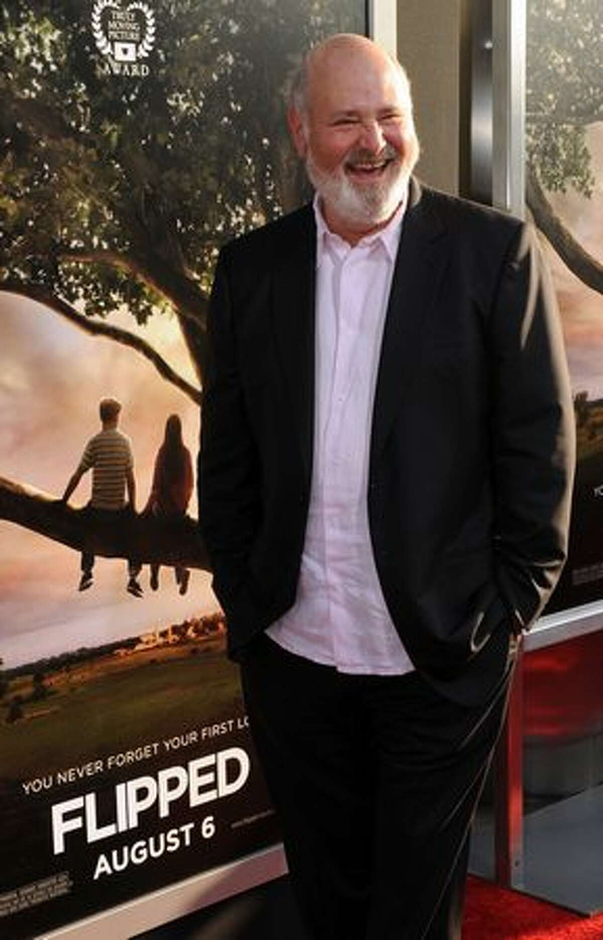 """Director Rob Reiner poses on the red carpet as he arrives for the premiere of his movie """"Flipped"""" at the Cinerama Dome Theater in Hollywood."""