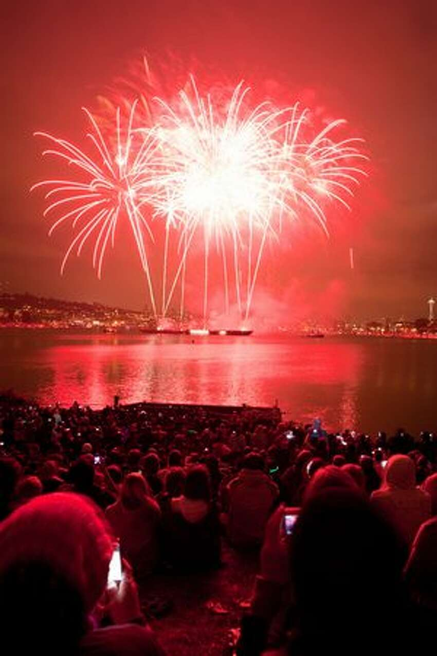 The audience watches as fireworks are launched over Lake Union during Seattle's Family 4th Celebration.