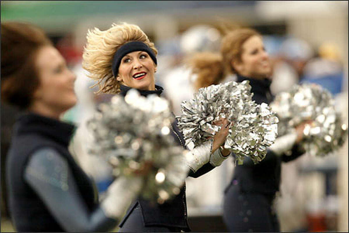 Sea Gal Shannon Kingsley, a 13-year veteran of the Seahawks cheering squad, does a routine with her teammates during the Seahawks' victory over the Detroit Lions.