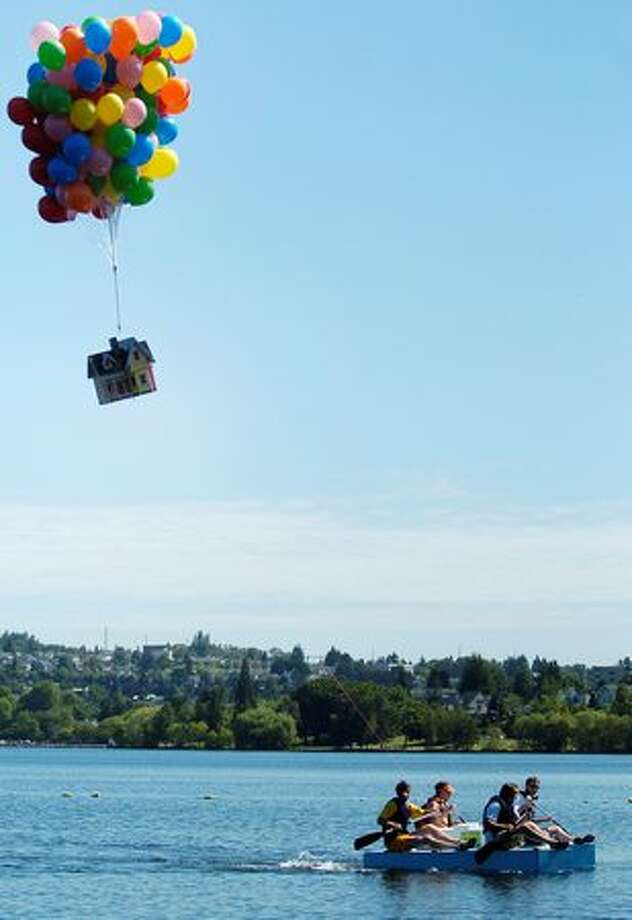 """The Wilderness Explorers pull along a replica of the balloon flown house from """"Up"""" during the second heat of the open adult category. Photo: Sang Cho, Seattlepi.com"""