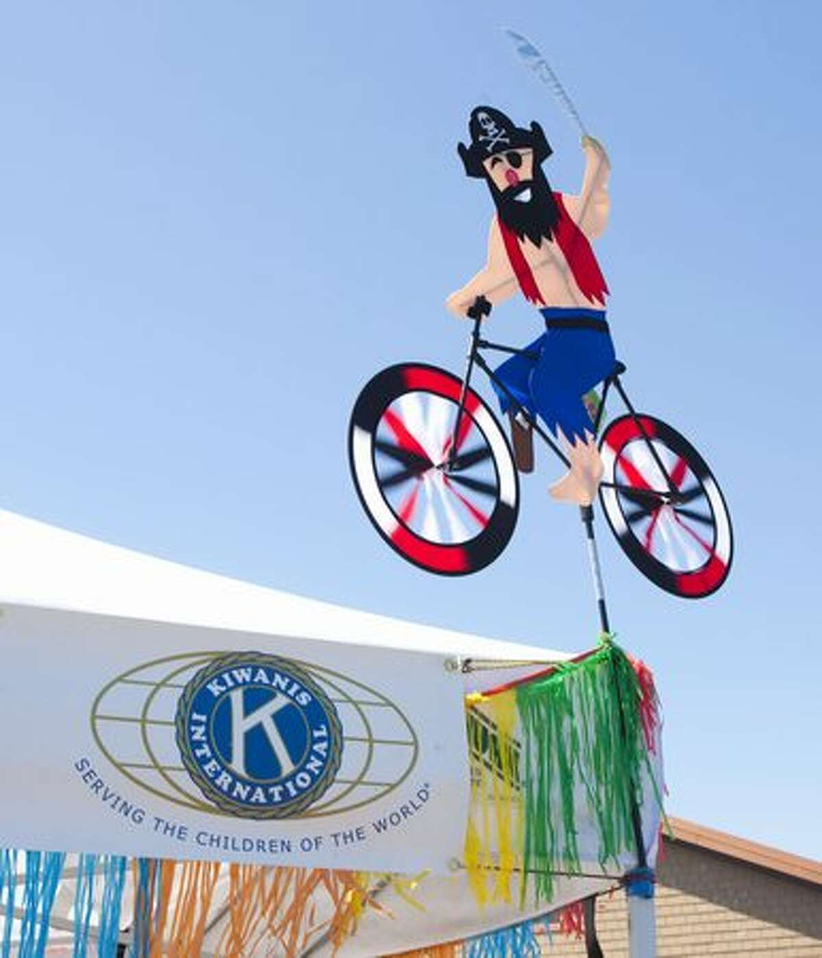 A windmill pirate cycles above the Kiwanis booth.