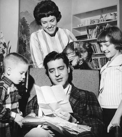 The Jan. 1966 photo caption read: Chris Wedes and his family, son Jimmie, 5; wife Joan; daughter Kathy, 9. His dog is Fritzie, a miniature schnauzer. Wedes is reading letters from kids after he was injured in a traffic accident. Photo: P-I File
