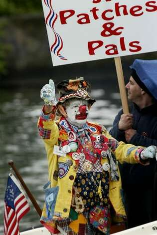 J.P. Patches waves to fans from a boat March 3, 2008 at the Montlake Cut (Dan DeLong/Seattlepi.com file) Photo: P-I File
