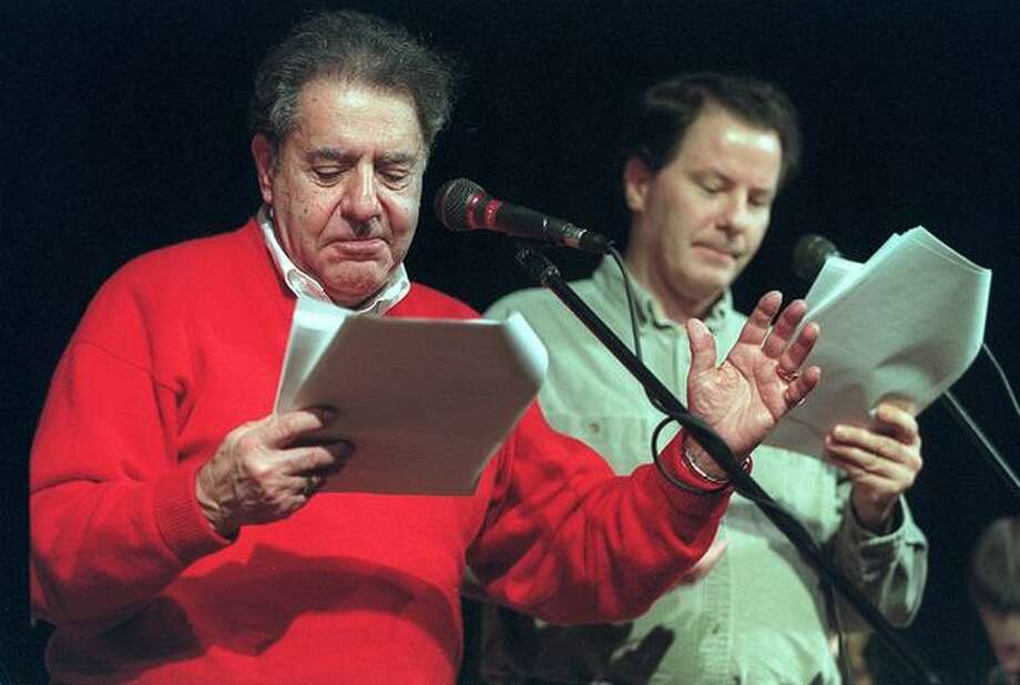 "Chris Wedes, left, practices for ""A Homefront Christmas"" at the Museum of History and Industry. The live radio show was broadcast in December 2001. Photo: P-I File"