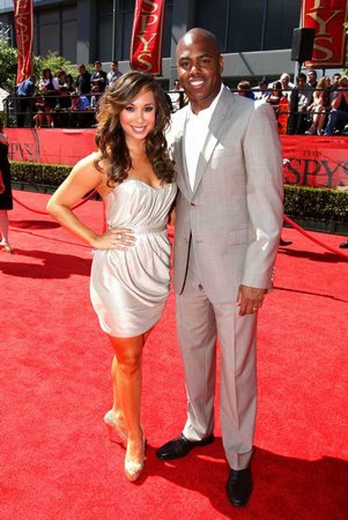 TV personalities Kevin Frazier and Cheryl Burke arrive.