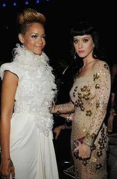 Singer Rihanna (left) and Katy Perry in the audience. Photo: Getty Images