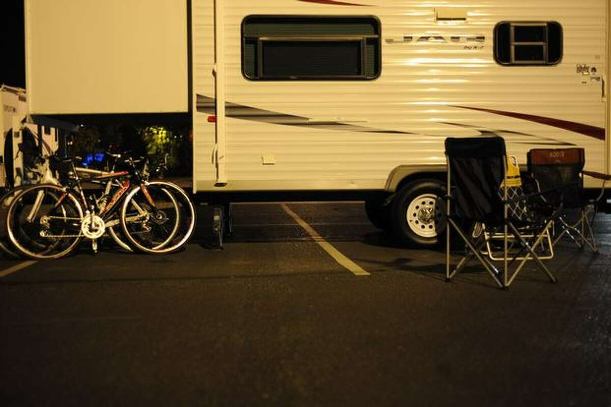 RVs are parked next to Husky Stadium as riders prepare for the annual Seattle to Portland bike ride on July 17, 2010.