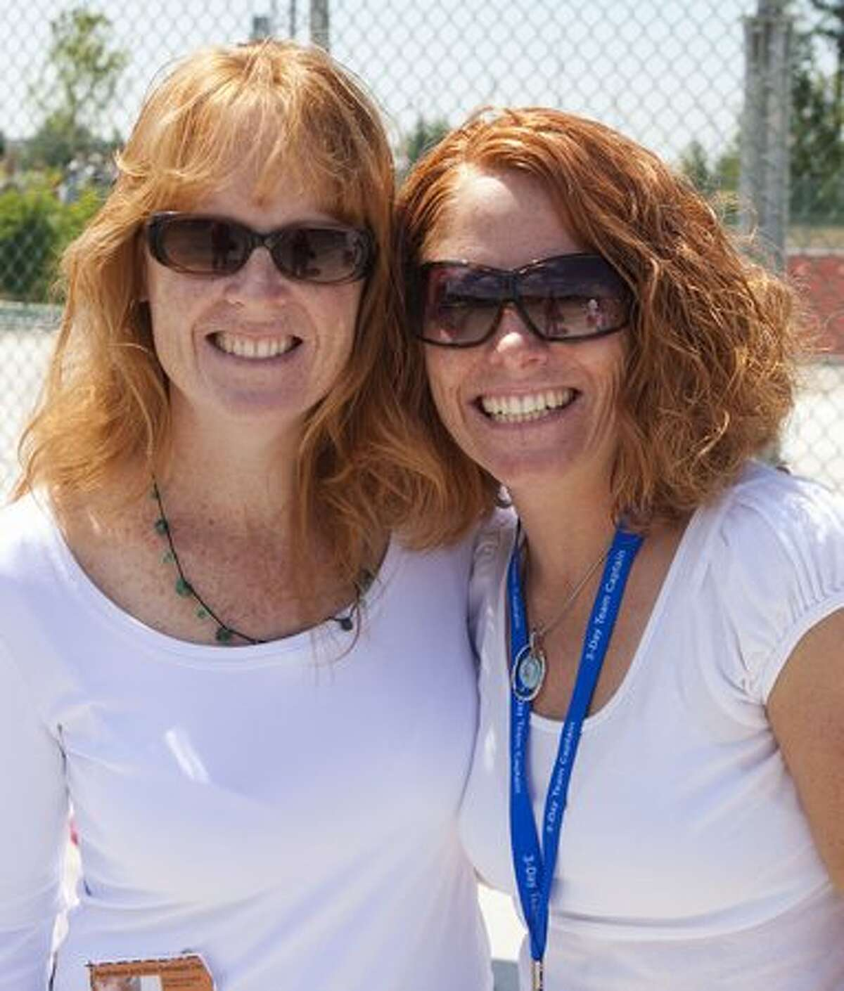 Kathy Kinard, left, and Angela Huber helped break the Guinness World Record for the largest gathering of natural redheads at Redheads and More Redheads Day in Sammamish.