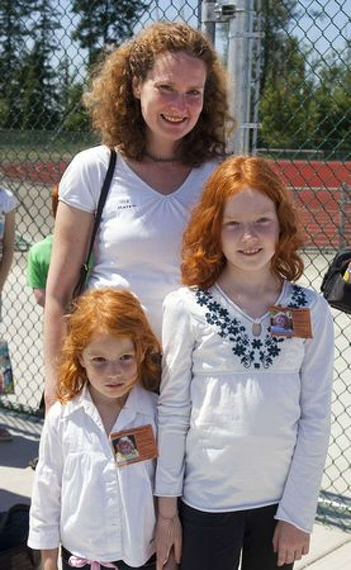 Lisann, 4, Laura, 9 and Maren Draeger were visiting from Germany and decided to participate in Redheads and More Redheads Day.