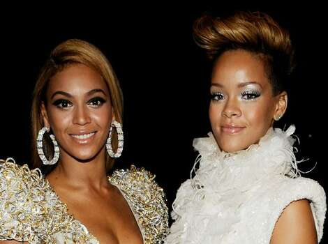 Singers Celine Dion (left) and Beyonce Knowles backstage. Photo: Getty Images