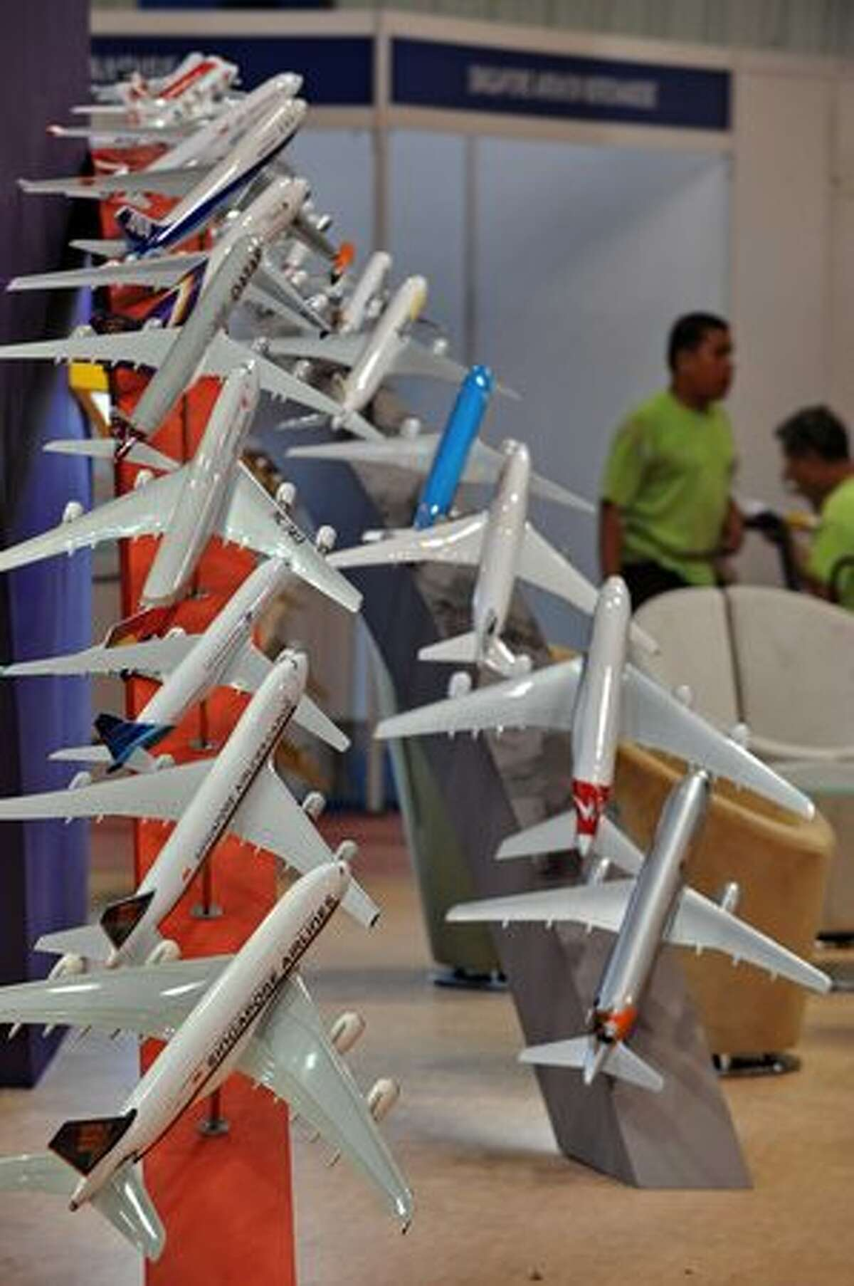 Models of various airlines' planes are displayed at the Singapore airshow on Feb. 1, 2010.