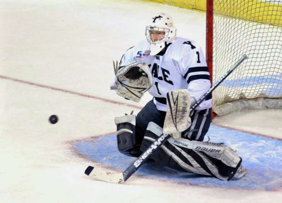 Yale goalie Ryan Rondeau prepares to deflect a shot by Air Force, during NCAA hockey tournament action at the Webster Bank Arena at Harbor Yard in Bridgeport on Wednesday March 25, 2011. Photo: Christian Abraham / Connecticut Post