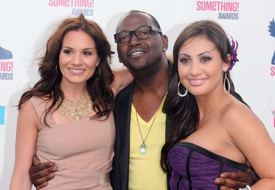 (L-R) TV personalities Kara DioGuardi, Randy Jackson and actress Francia Raisa arrive. Photo: Getty Images