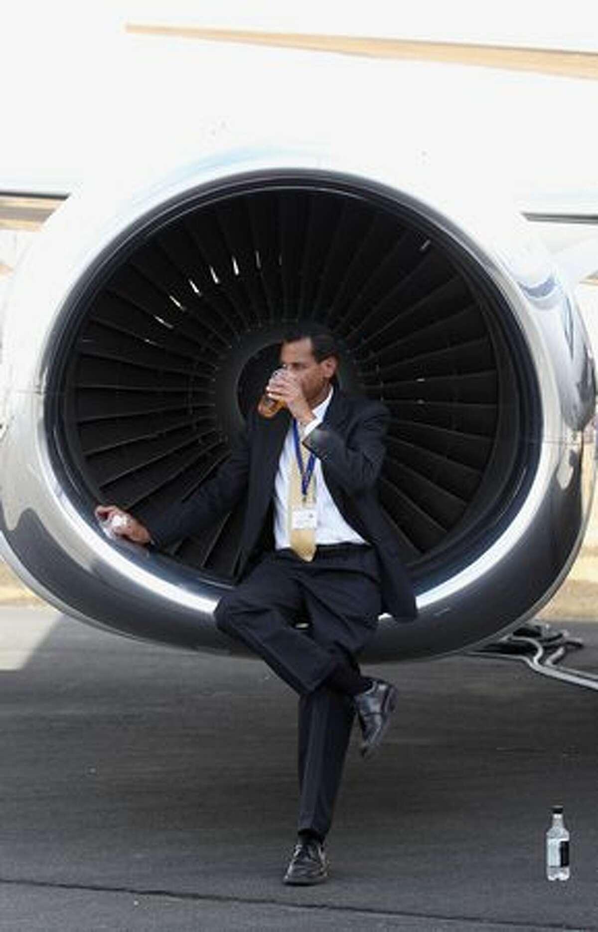 A man relaxes at the Farnborough International Airshow, in Farnborough, England.