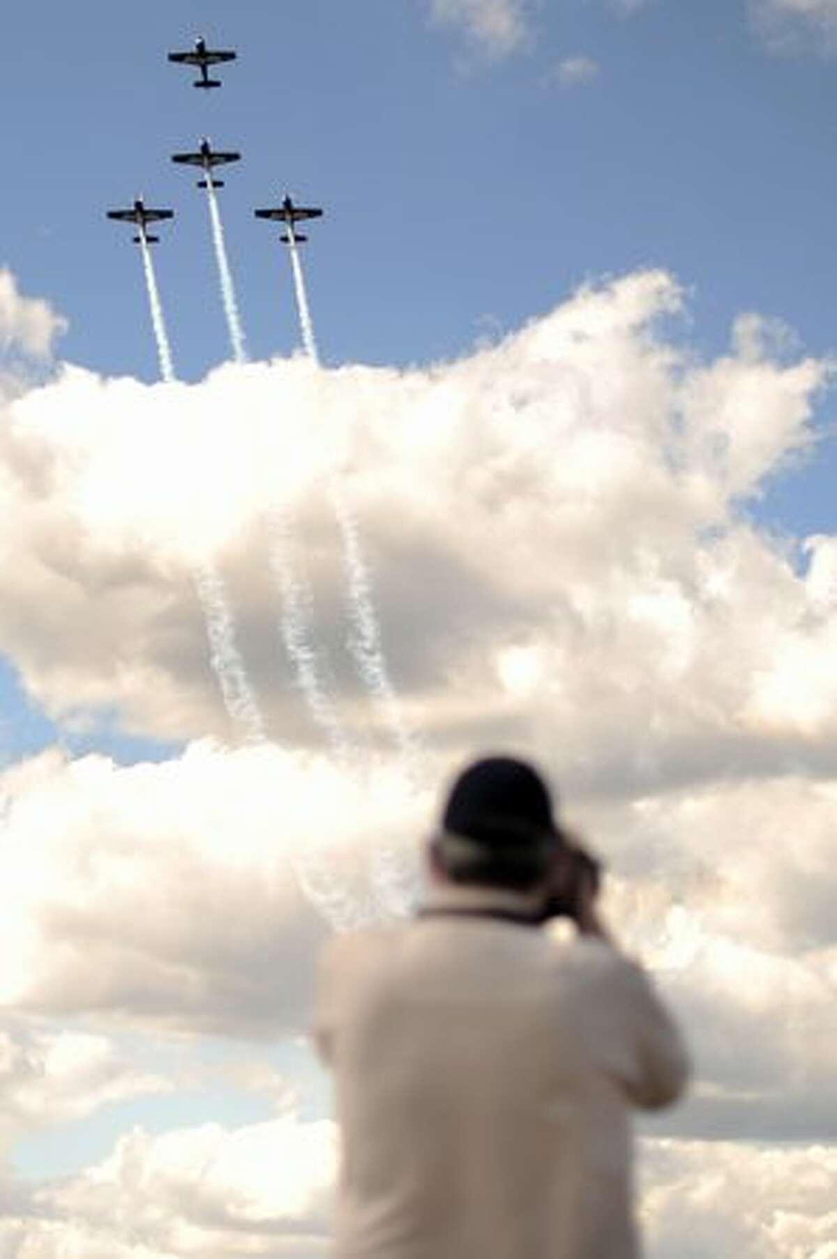 A spectator watches as the Blades aerobatic team perform during an air display at the Farnborough International Airshow, in Farnborough, England.