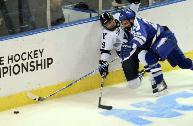 Highlights from NCAA hockey tournament action between Yale and Air Force at the Webster Bank Arena at Harbor Yard in Bridgeport on Friday March 26, 2011. Yale's #9 Brian O'Neill and Air Force's #25 Tim Kirby struggle for the puck. Photo: Christian Abraham / Connecticut Post