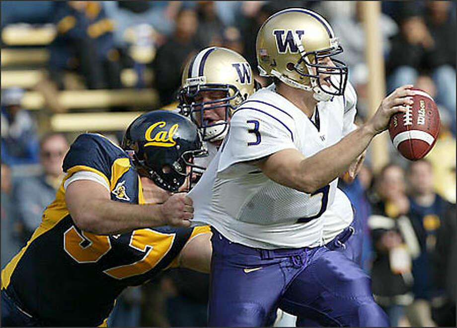 California defensive tackle Josh Beckham sacks Washington quarterback Cody Pickett during the second quarter in Berkeley, Calif., Saturday, Nov. 15, 2003. (AP Photo/Jeff Chiu) Photo: Associated Press