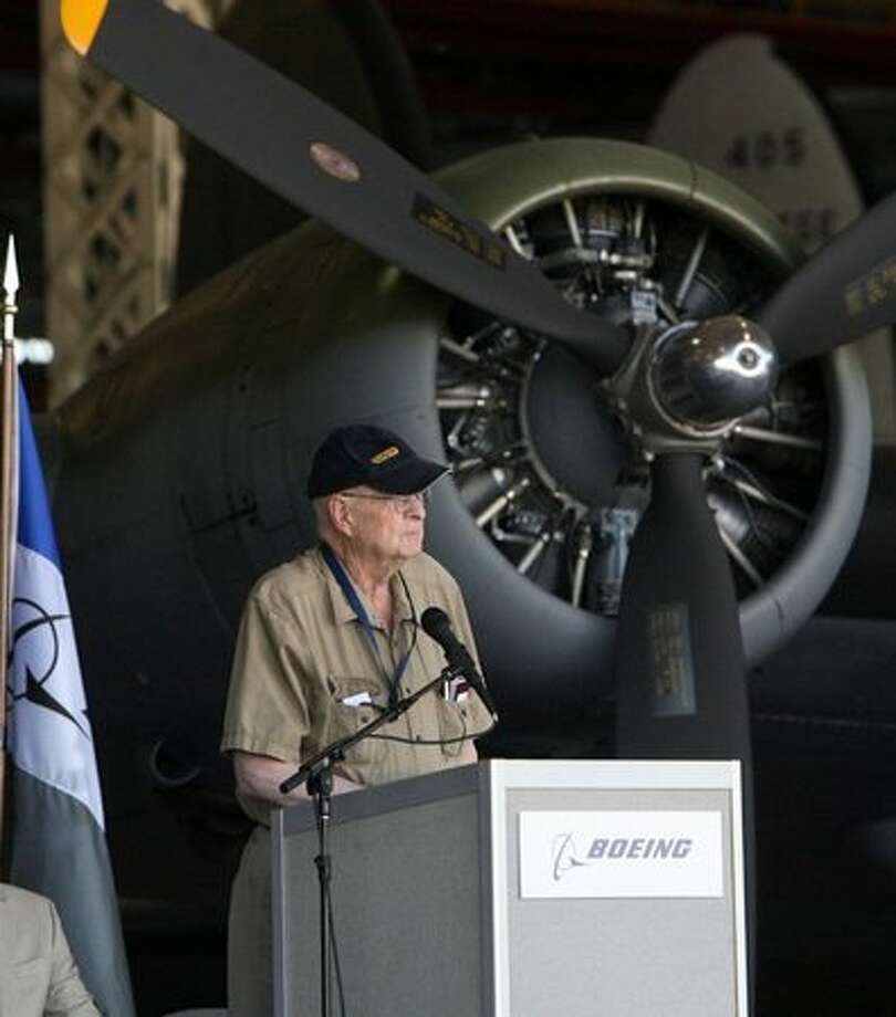 Walt Creigh, who piloted a B-17 Flying Fortress during World War II, speaks in front of the Museum of Flight's B-17 during a ceremony at Boeing's Plant 2 to mark the 75th anniversary of the B-17's first flight. Photo: Aubrey Cohen, Seattlepi.com
