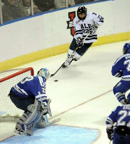 Highlights from NCAA hockey tournament action between Yale and Air Force at the Webster Bank Arena at Harbor Yard in Bridgeport on Friday March 26, 2011. Yale's #22 Brendan Mason, top, converges on the Air Force goal. Photo: Christian Abraham / Connecticut Post