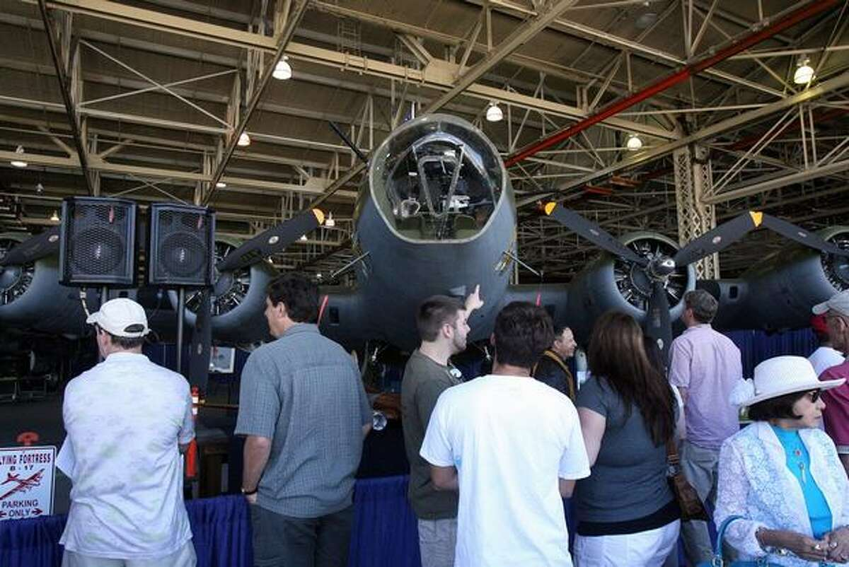 Visitors check out the Museum of Flight's restored B-17 Flying Fortress during a ceremony at Boeing's Plant 2 to mark the 75th anniversary of the B-17's first flight.