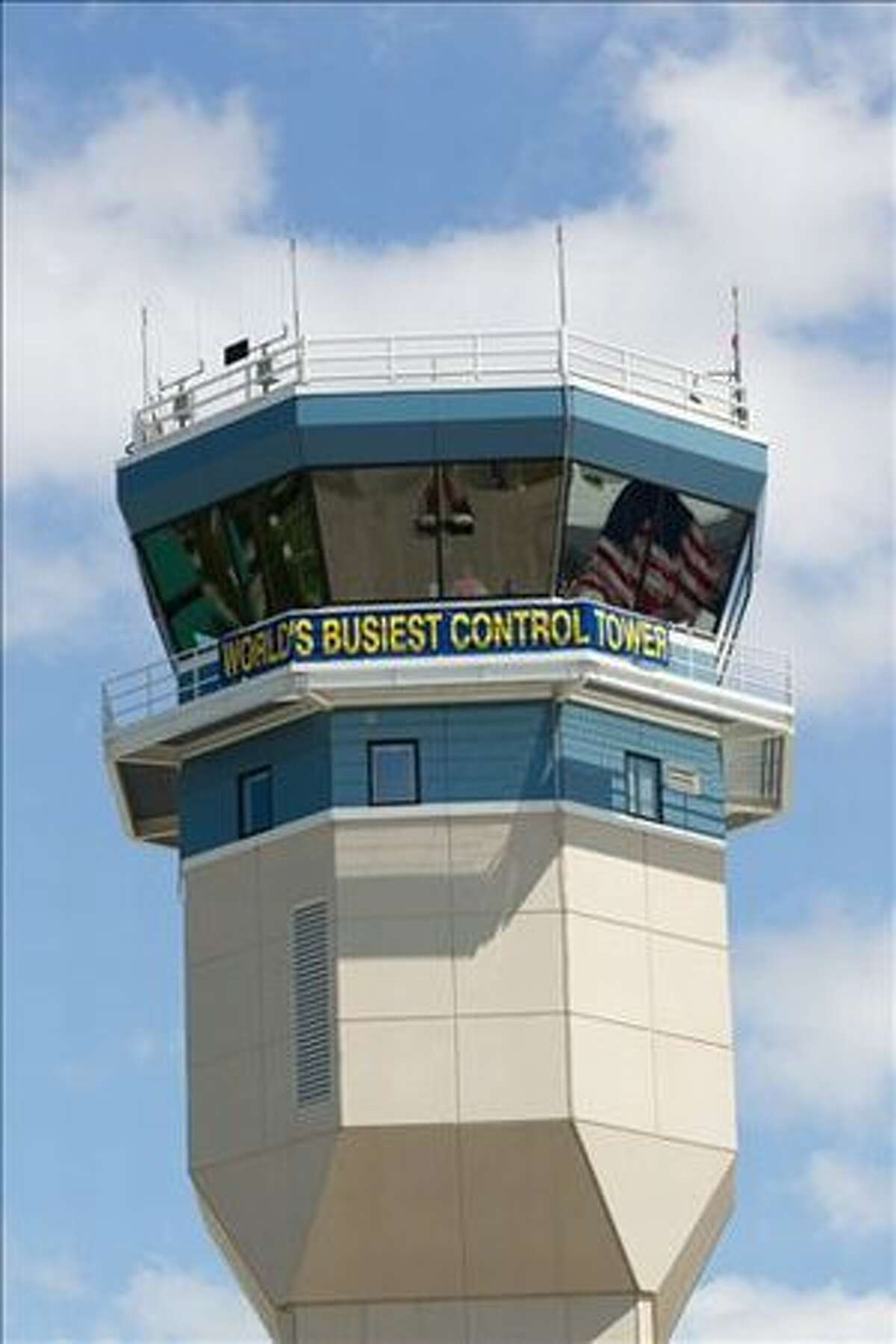 The cab of the Wittman Regional Aircraft Tower captures the reflection of the U.S. flag. (Jim Koepnick/EAA)
