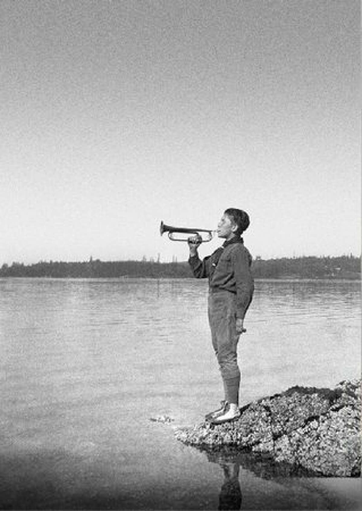 L. Ron Hubbard in 1924, with his bugle on Puget Sound in Bremerton, WA. (Author Services, Inc. - LRonHubbard.org)