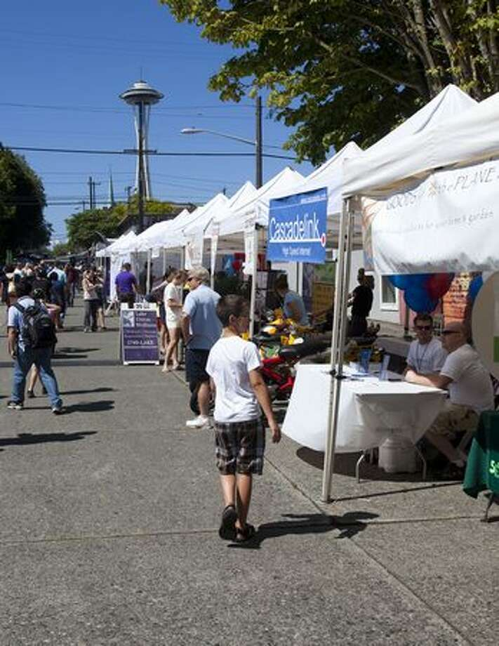 Booths line the walkway at the South Lake Union Block Party. Photo: Angela Nickerson, Seattlepi.com