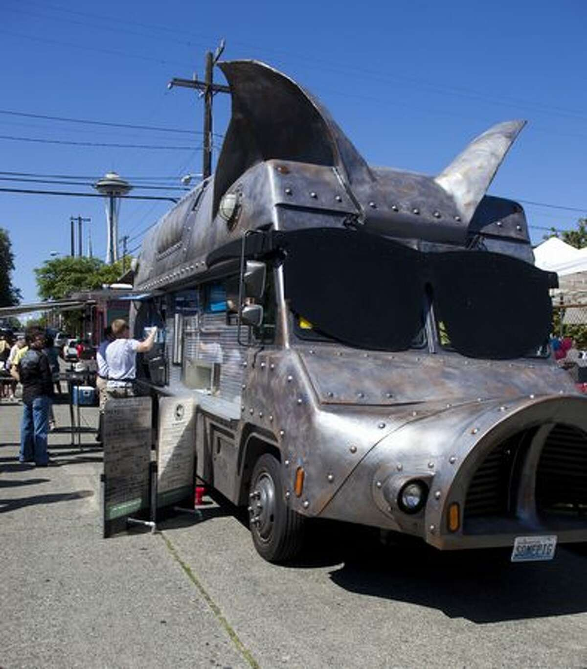 """""""Maximus Minimus"""" serves food to hungry guests at the SLU Block Party."""