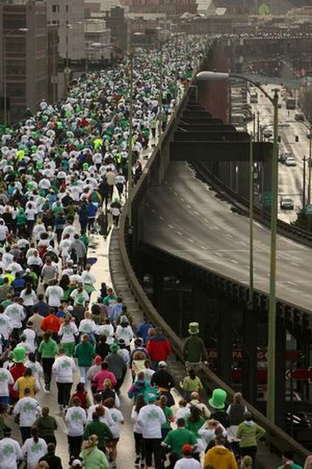Participants run south in the northbound lanes of the Alaskan Way Viaduct during the St. Patrick's Day Dash, March 16, 2008. Photo: P-I File