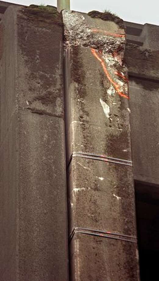 An Alaskan Way Viaduct support column at South Washington Street leans outward and is secured with metal straps, April 1, 2001. Photo: P-I File