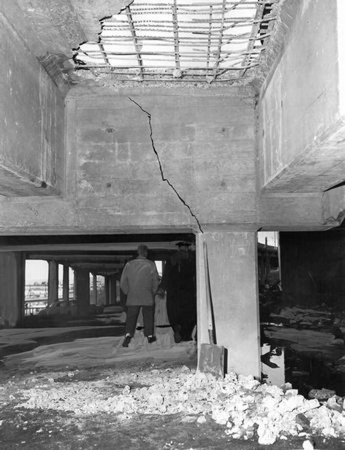 The Jan. 8, 1962 photo caption read: Part of damage to the Alaskan Way Viaduct caused by the fall of part of the old Armory. Photo: P-I File