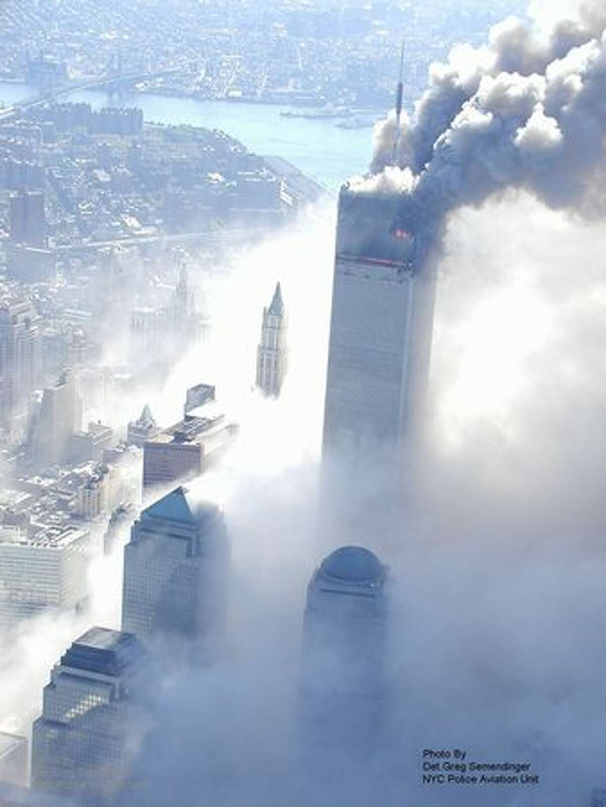 This photo taken Sept. 11, 2001 by the New York City Police Department and obtained by ABC News under the Freedom of Information Act years later shows a World Trade Center tower burning after it was hit by a passenger jet in New York. (AP Photo/NYPD via ABC News, Det. Greg Semendinger)