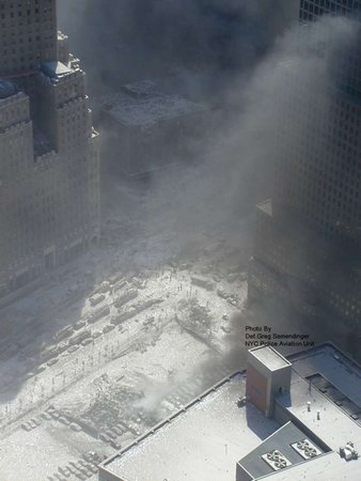 This photo taken Sept. 11, 2001 by the New York City Police Department and obtained by ABC News in 2010, which claims to have obtained it under the Freedom of Information Act, shows white ash covering the downtown area near the grounds of the World Trade Center in New York. (AP Photo/NYPD via ABC News, Det. Greg Semendinger)