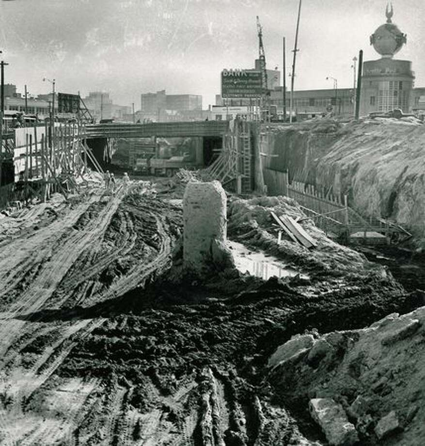 The Oct. 5, 1953 photo caption read: This view of new subway south toward The Post-Intelligencer building shows retaining walls under construction on each side, the north portal of Battery Street subway and extent of excavation. Photo: P-I File
