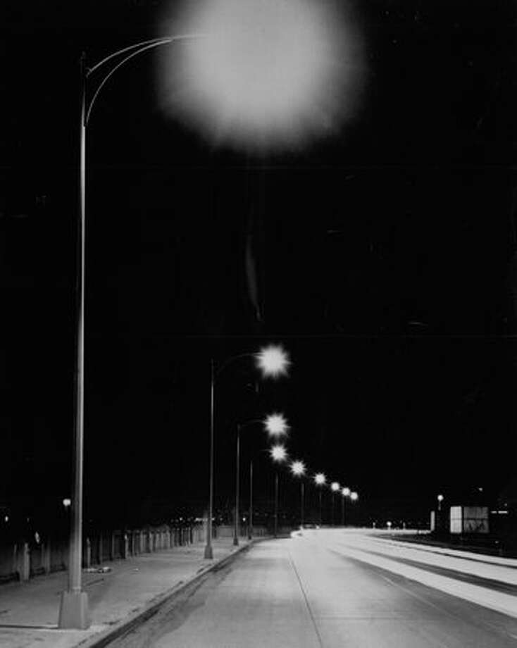 The Aug. 17, 1956 photo caption read: Steel poles, used for new luminous lighting on Alaskan Way were manufactured by Pacific Car and Foundry Company's Renton plant. Photo: P-I File