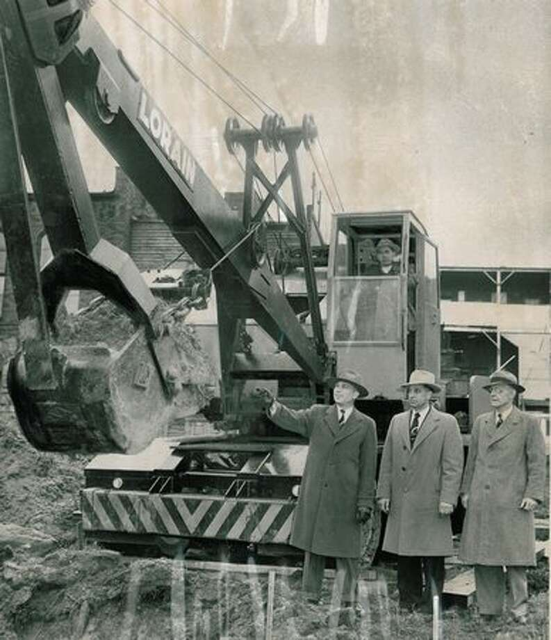 The Feb. 7, 1950 photo caption read: City Engineer R. W. Finke, left, gives go-ahead, and power shovel digs first scoop of dirt preparatory for construction of first unit of Alaskan Way Viadcut near Western Avenue and Battery Street. Photo: P-I File