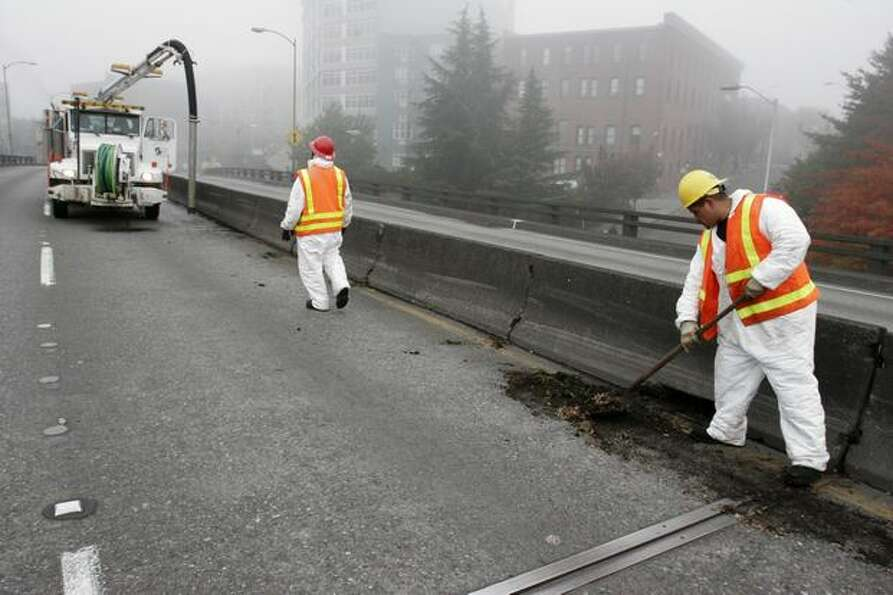 State Department of Transportation maintenance crews clean the viaduct, near Battery Street, Oct. 13