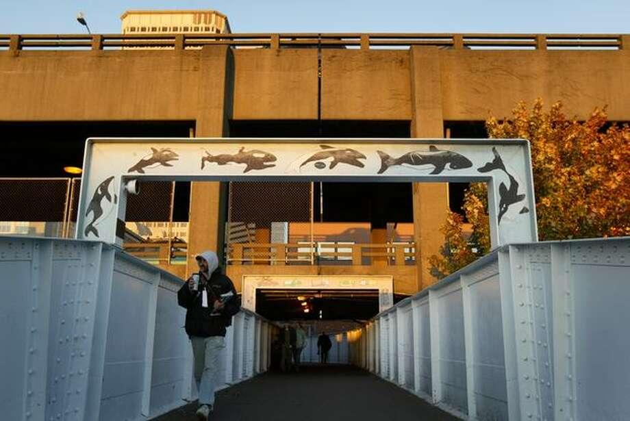 A pedistrian walks under the Alaskan Way Viaduct toward Coleman Dock on Oct. 26, 2007. Photo: P-I File