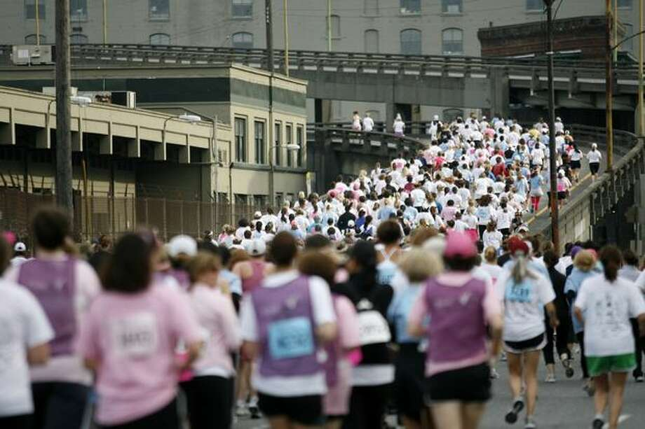 Racers run along the viaduct during the Susan G. Komen Race for the Cure, June 21, 2008. Photo: P-I File