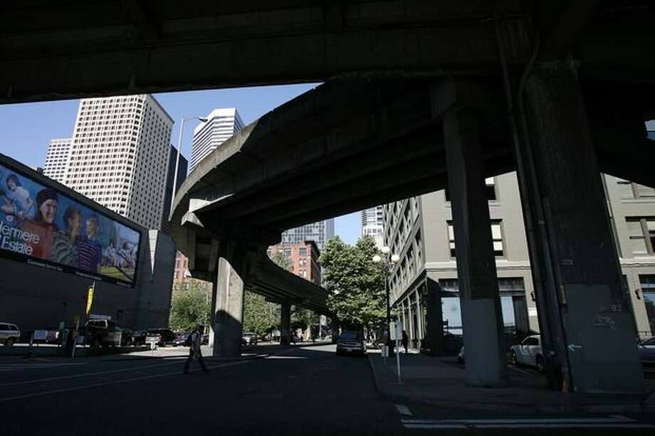 An onramp to the Alaskan Way Viaduct at Columbia Street winds its way through downtown. Photo: P-I File