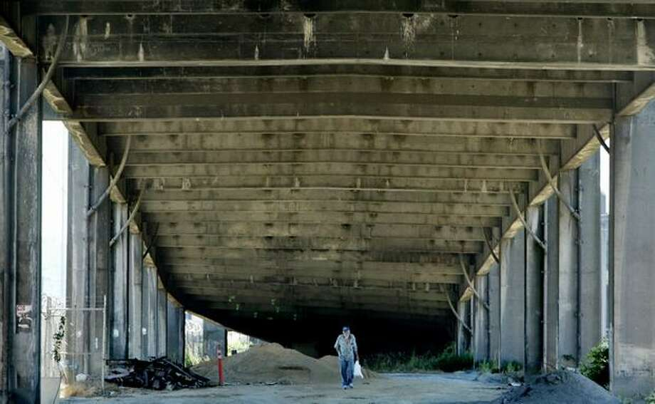A man walks below the Alaskan Way Viaduct, near South Atlantic Street, July 24, 2006. Photo: P-I File
