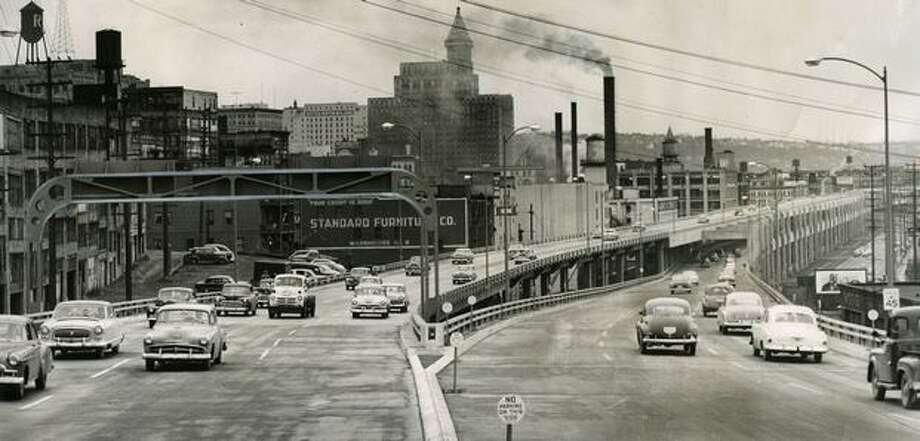 Traffic moves over the Alaskan Way Viaduct after opening ceremonies, Saturday, April 4, 1953. The view is to the south. Photo: P-I File