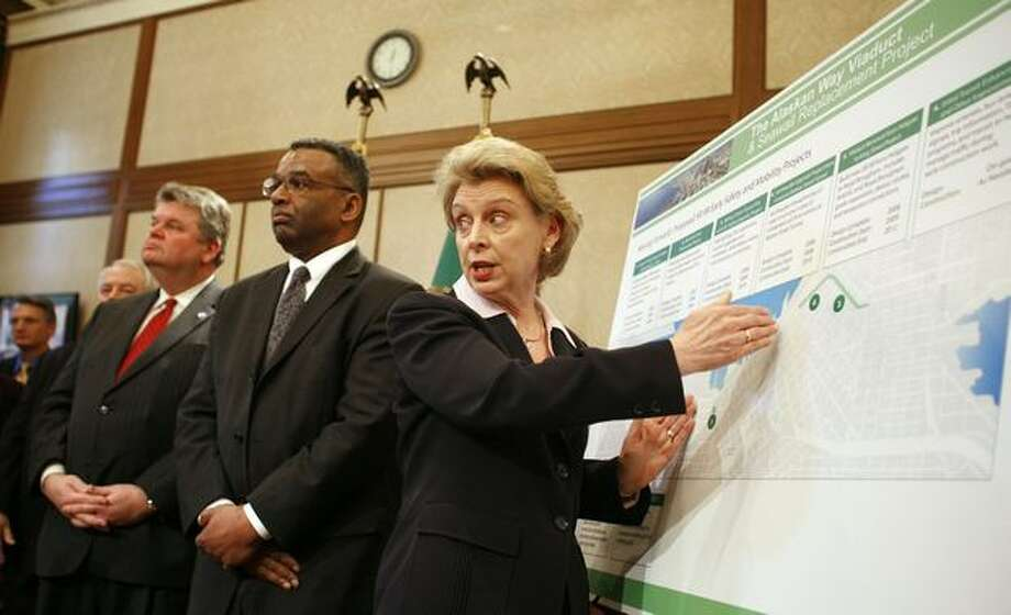Gov. Chris Gregoire uses a chart while Seattle Mayor Greg Nickles and King County Executive Ron Sims listen to options for replacing the Alaskan Way Viaduct during an Olympia news conference, March 14, 2007. That month, Seattle voters didn't favor a tunnel or an elevated replacement for the existing viaduct, complicating an already messy struggle between city and state leaders. The struggle continues. Photo: P-I File