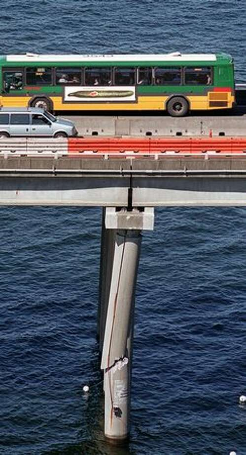 The August 2000 photo caption read: The damaged support column on the eastbound highrise of the 520 bridge. The pier was damaged in a collision with a barge last weekend. Photo: P-I File