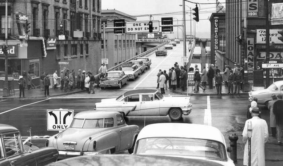 The Nov. 1961 photo caption read: The first cars leaving the viaduct via Seneca Street. Photo: P-I File