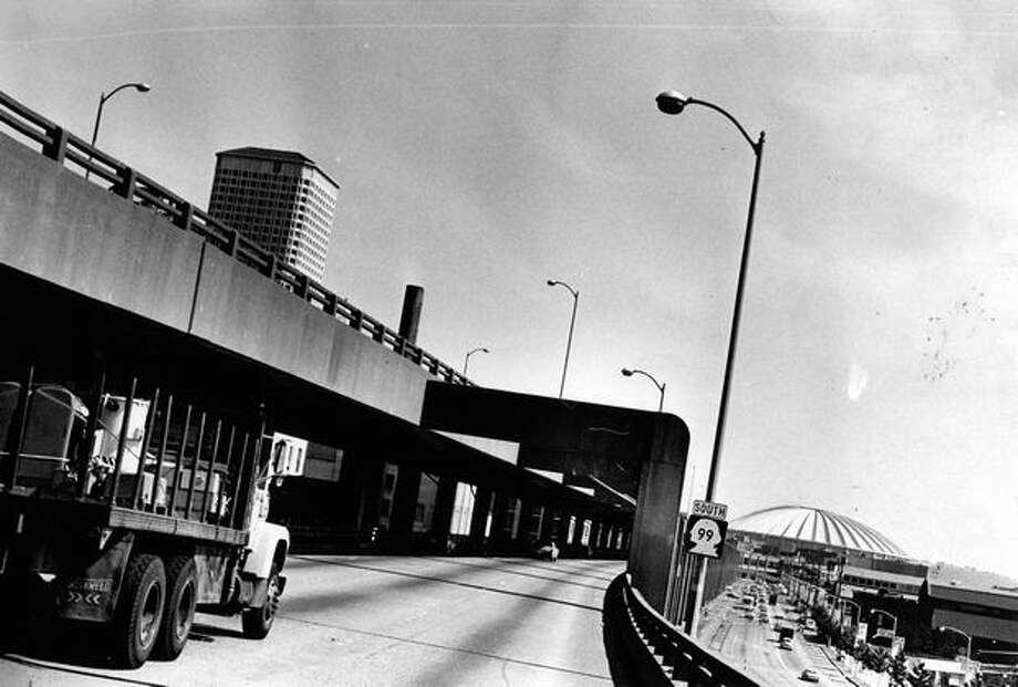 The August 14, 1977 photo caption read: 54,000 vehicles a day roar above the waterfront on the Alaskan Way Viaduct. Photo: P-I File