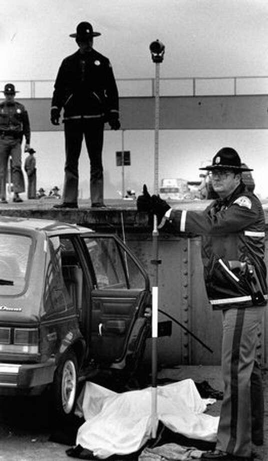 A car crash investigation, Dec. 22, 1989. Photo: P-I File