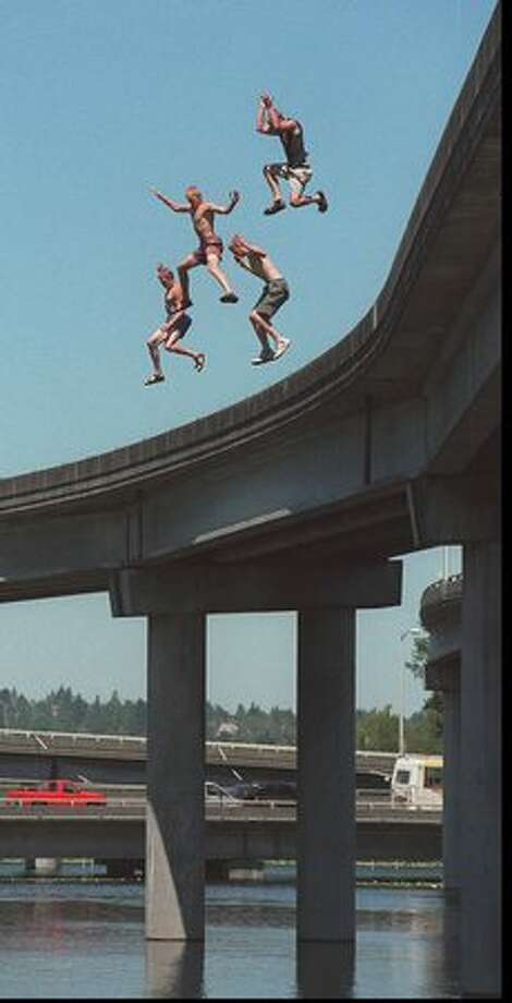 Jumpers make a roughly 40-foot plunge off the 520 bridge, July 1996. Photo: P-I File