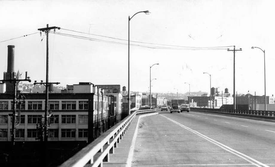 The Feb. 1, 1960 photo caption read: Most motorists don't notice wires over high-speed freeways, such as this one over the new Alaskan Way Viaduct. Photo: P-I File