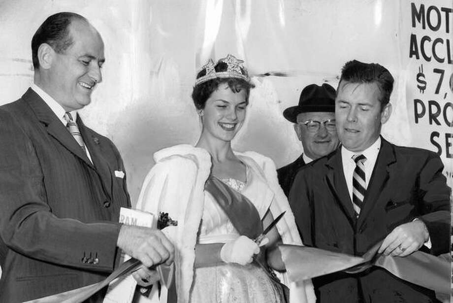 The Sept. 1959 photo caption read: Seafair Queen Diane Gray applies the scissors with gusto yesterday at a ribbon-cutting ceremony opening the Spokane Street extension of the Alaskan Way Viaduct. [Former Gov. Al Rosellini and then-Mayor Gordon Clinton are on the left and right, respectively.] Photo: P-I File